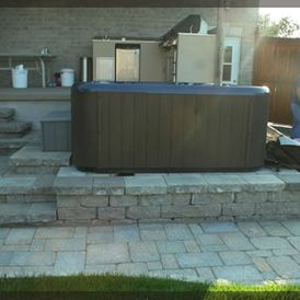 Stonework around hot tub