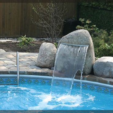 Swimming pool with stone and water cascade